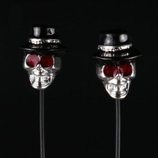На картинке наушники с черепом в шляпе, детали.
