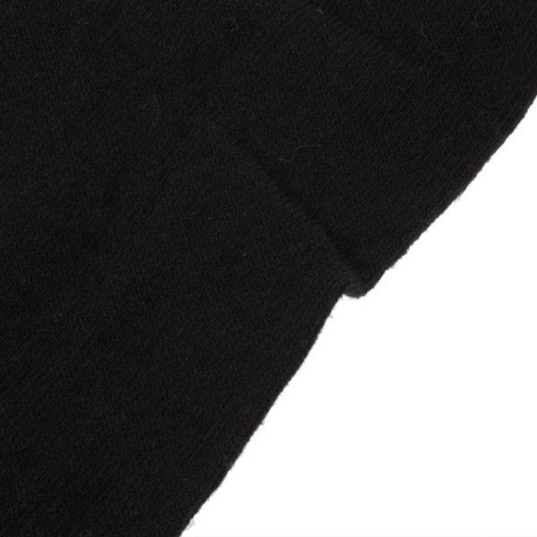 На картинке черные гольфы выше колена, детали.