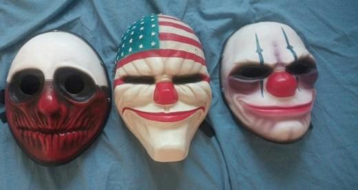 На картинке маски из Рayday 2 (Пейдей), 3 варианта. вид спереди.