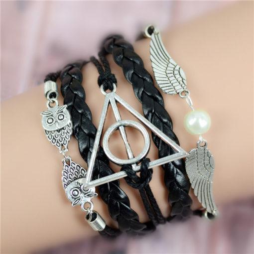 На картинке браслет со знаком «Даров смерти» (Гарри Поттер) — 3 варианта, крупный план.