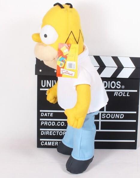 На картинке мягкая игрушка Гомер Симпсон «Simpsons», вид сбоку.