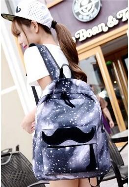 На картинке рюкзак космос с усами (усиками), общий вид, вариант серый.