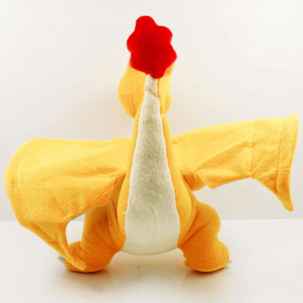 На картинке мягкая игрушка покемон Чаризард (Покемон), вид сзади.