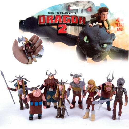 На картинке фигурки героев из мультфильма «Как приручить дракона 2″, вид спереди.