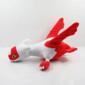 На картинке мягкая игрушка покемон Латиас (latias), вид сбоку.