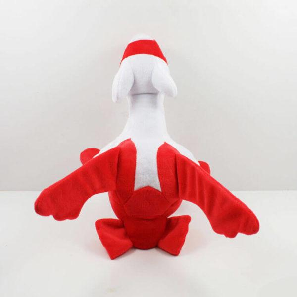 На картинке мягкая игрушка покемон Латиас (latias), вид сзади.