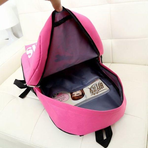 На картинке портфель с миньонами (Гадкий Я), вид внутри, цвет розовый.