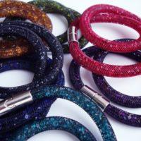 На картинке браслеты в стиле Stardust Swarovski (Сваровски) 13 вариантов, общий вид.