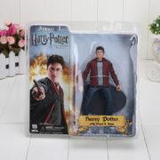 На картинке фигурка Гарри Поттера (Harry Potter), вид в упаковке.