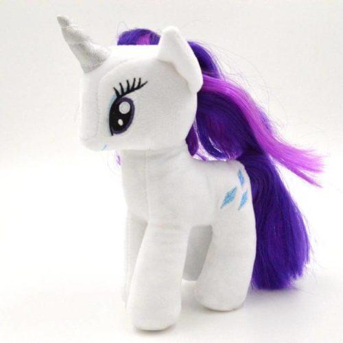 На картинке мягкая игрушка пони Рарити из Май Литл Пони (My little pony \ Дружба это чудо), вид сбоку.